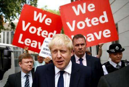 FILE PHOTO: Boris Johnson leaves his office in London