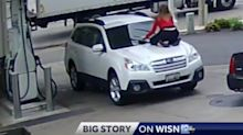 Woman jumps onto the hood of moving car to prevent carjacking at petrol station
