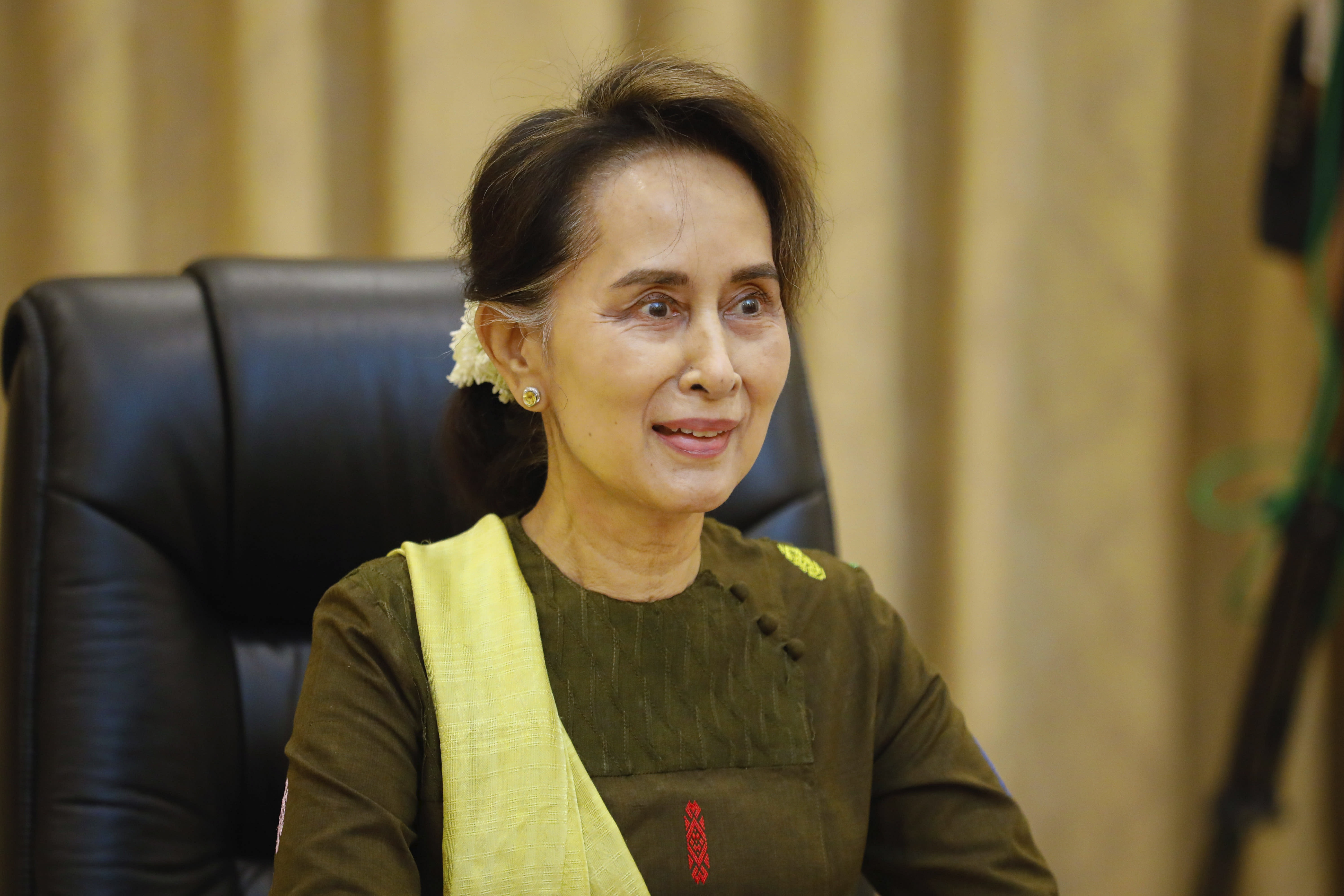 In this handout image provided by the Myanmar State Counsellor Office, Myanmar leader Aung San Suu Kyi is shown while she attends a video conference, Friday, July 3, 2020, in Naypyitaw, Myanmar. Suu Kyi expressed sadness Friday over a landslide at a jade mining site in the country's north that took over 100 lives, blaming the tragedy on joblessness. (Myanmar State Counsellor Office via AP)