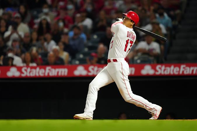 ANAHEIM, CA - JULY 05:  Shohei Ohtani #17 of the Los Angeles Angels singles during the game between the Boston Red Sox and the Los Angeles Angels at Angel Stadium on Monday, July 5, 2021 in Anaheim, California. (Photo by Daniel Shirey/MLB Photos via Getty Images)
