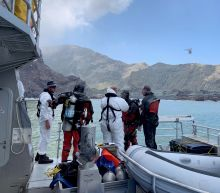 Specialist teams hope to recover last 2 volcano victims