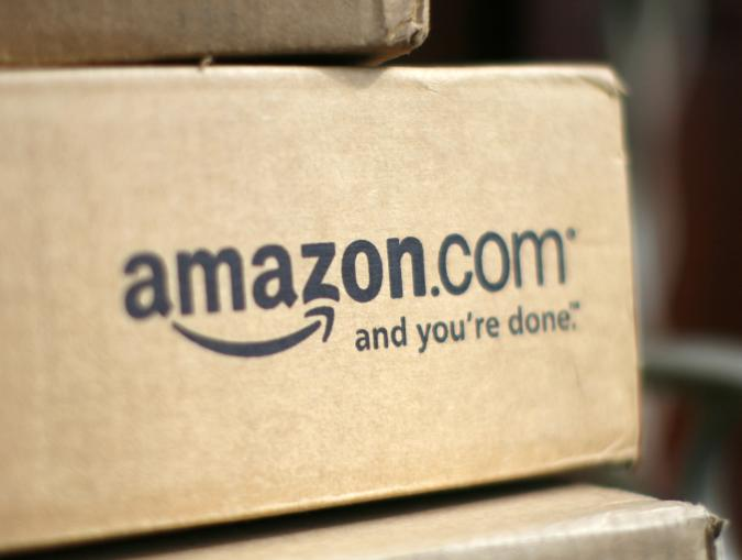 A box from Amazon.com is pictured on the porch of a house in Golden, Colorado July 23, 2008. Online retailer Amazon.com Inc said on Wednesday its quarterly profit doubled on a 41 percent rise in revenue, sending its shares up more than 6 percent.  REUTERS/Rick Wilking (UNITED STATES)