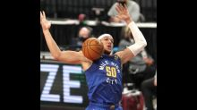 Nuggets look to exact revenge in visit to Warriors
