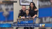 Girl battling cancer sworn in as honorary police officer, promises to keep fighting 'the bad guys'