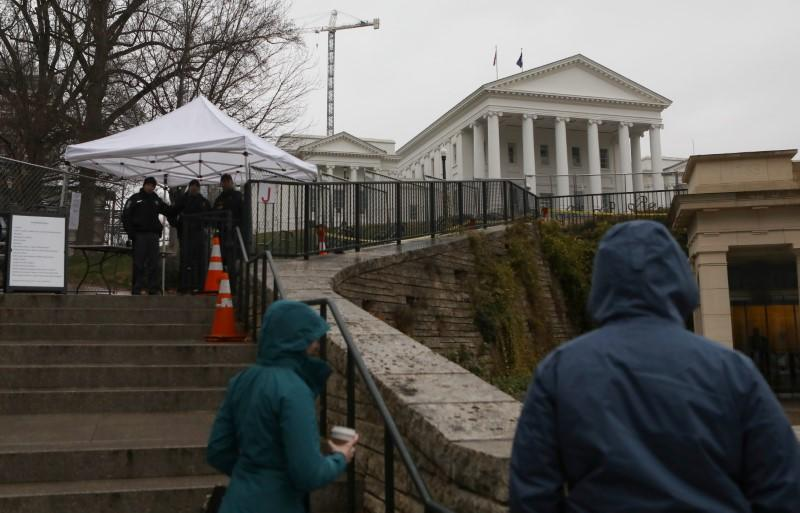 Law enforcement manage a security checkpoint to access the Virginia State Capitol grounds ahead of a gun rights advocates and militia members rally in Richmond, Virginia