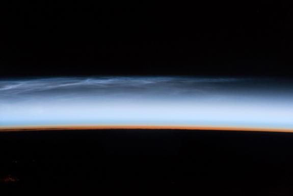 This silvery-blue layer of clouds, known as noctilucent clouds, is a rare, but increasingly more common occurrence.
