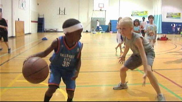Boy, 4, Has Game on the Basketball Court