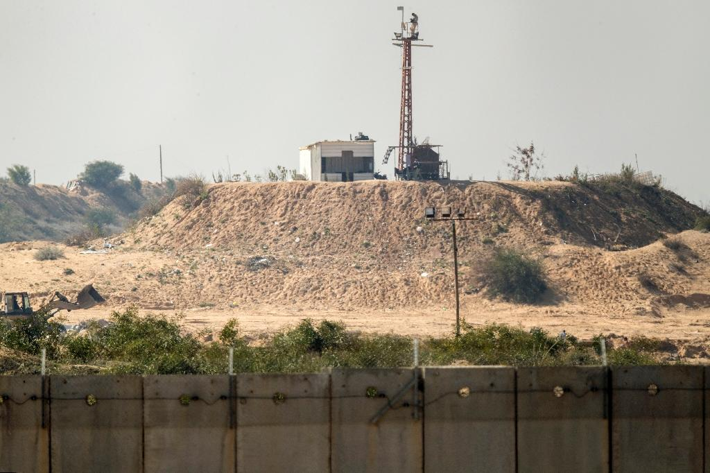 A Hamas outpost on the southern Israel-Gaza Strip border overlooks a section of the separation wall built by Israel