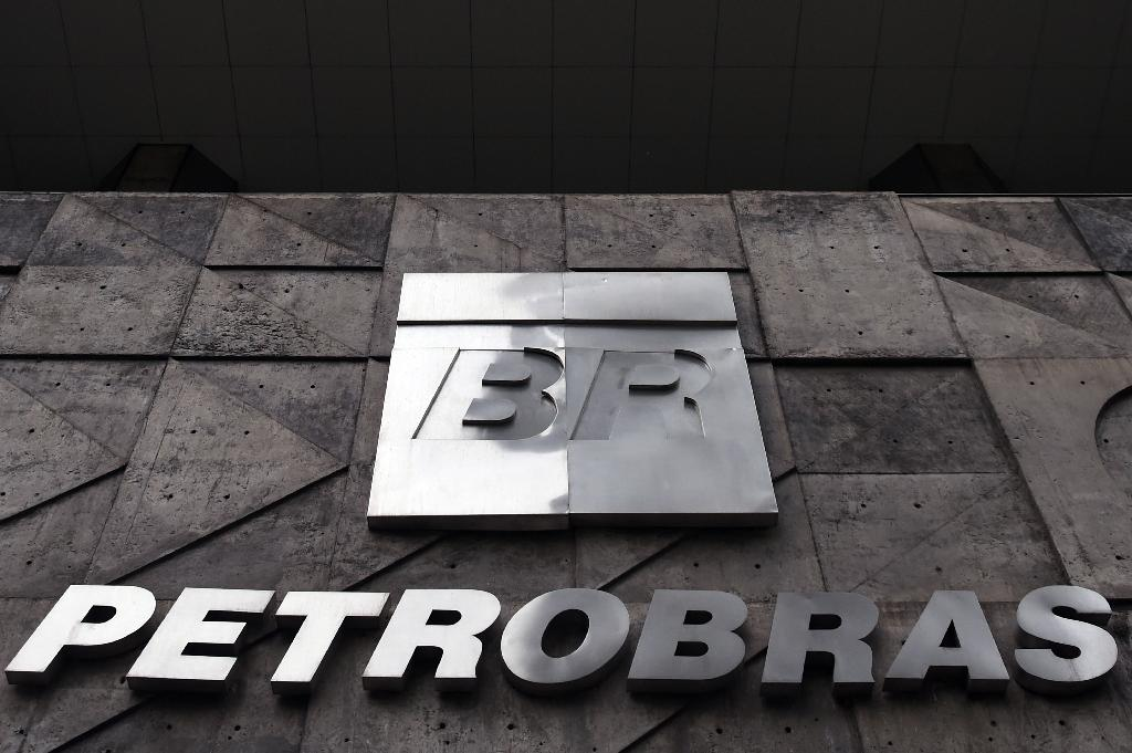 Brazil's scandal-plagued state oil giant Petrobras, mired in hugely damaging scandal involving bribes and high-level political payoffs, posted losses of 3.76 billion reais in the third quarter, compared with a loss of 5.3 billion reais a year earlier (AFP Photo/Vanderlei Almeida)