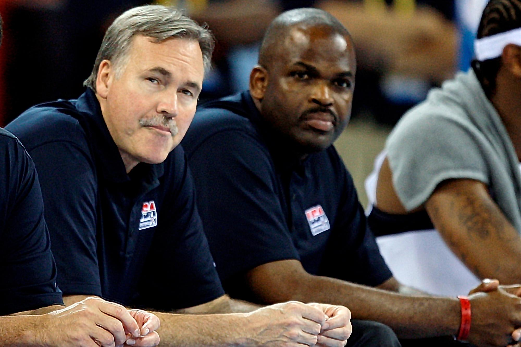 FILE - In this Aug. 10 2008, file photo, United States assistant coaches Mike D'Antoni,. left, and Nate McMillan watch during the men's basketball game at the Beijing 2008 Olympics in Beijing. Both coaches have spent an extended stretch away from home during the summer. While unprecedented as part of an NBA season, it isn't exactly a foreign concept for those with USA Basketball experience like the Olympics and the World Cup. (AP Photo/Dusan Vranic, File)