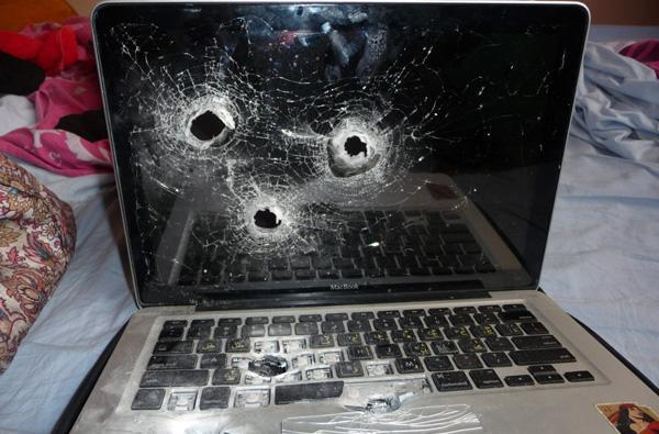 Border security guards kill -- literally kill -- a MacBook (update: video!)