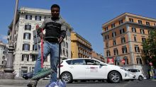Migrants sweep their way to integration in rubbish-strewn Rome