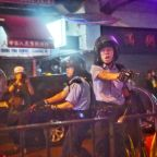 Hong Kong police fire first gunshot, water cannon in protest clashes
