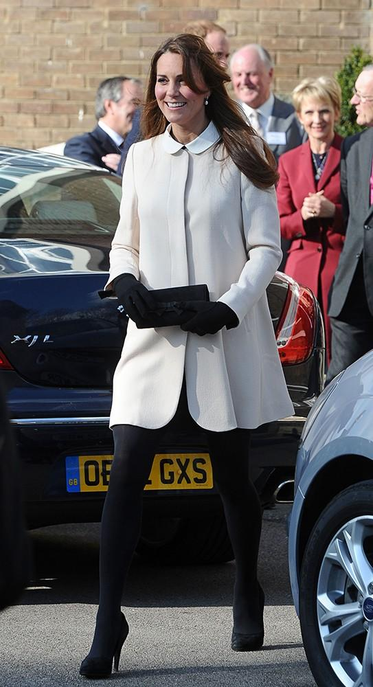 Dressed in a pretty white Redgrave Goat collarless coat over a dress from Topshop, Kate visited the headquarters of Child Bereavement UK.