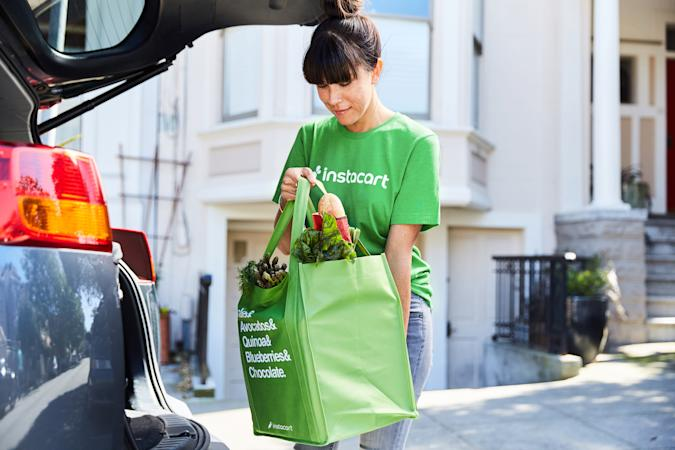 An Instacart shopper with groceries.
