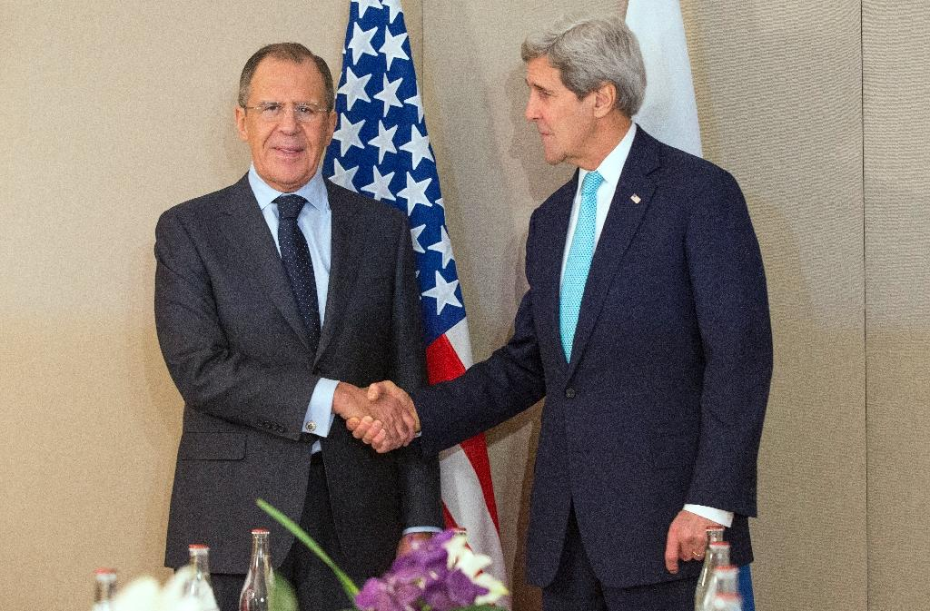 US Secretary of State John Kerry (right) shakes hand with Russian Foreign Minister Sergey Lavrov prior to a meeting in Geneva, on March 2, 2015 (AFP Photo/Evan Vucci)