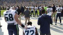 Michael Bennett sits, Martellus Bennett raises fist during Seahawks-Packers national anthem