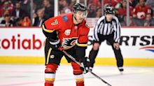 Flames' T.J. Brodie released from hospital after scary scene during practice