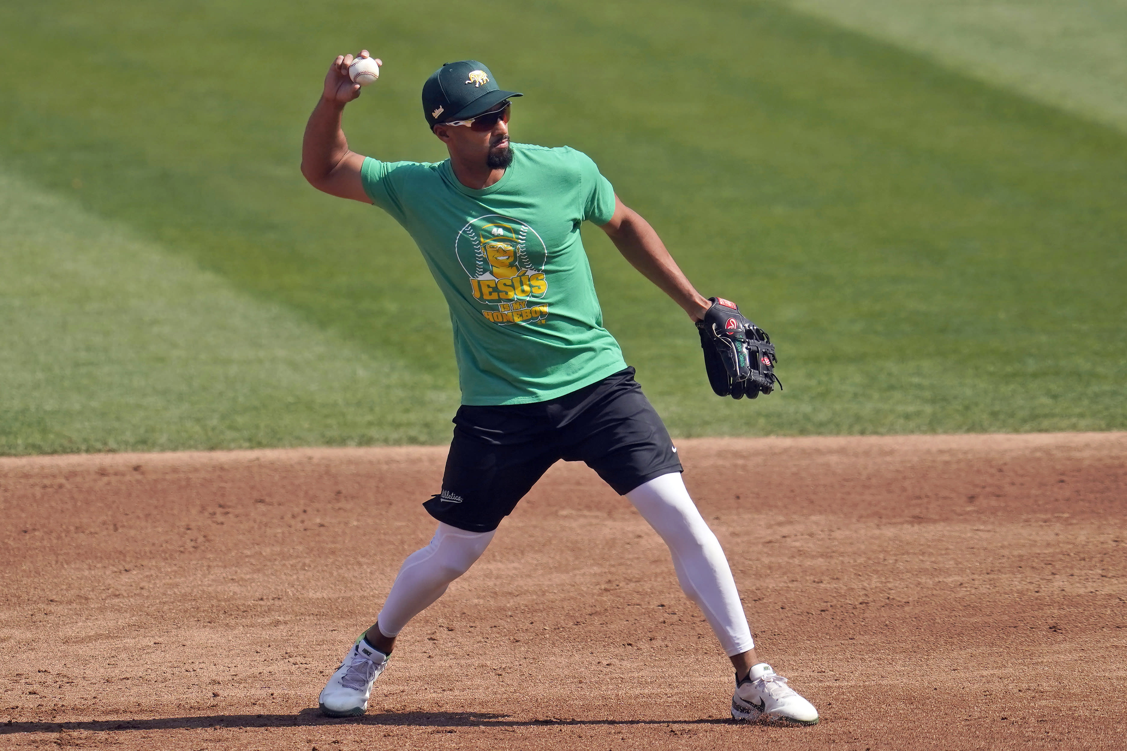 Oakland Athletics' Marcus Semien throws during a baseball workout in Oakland, Calif., Monday, Sept. 28, 2020. The Athletics are scheduled to play the Chicago White Sox in an American League wild-card playoff series starting Tuesday. (AP Photo/Jeff Chiu)