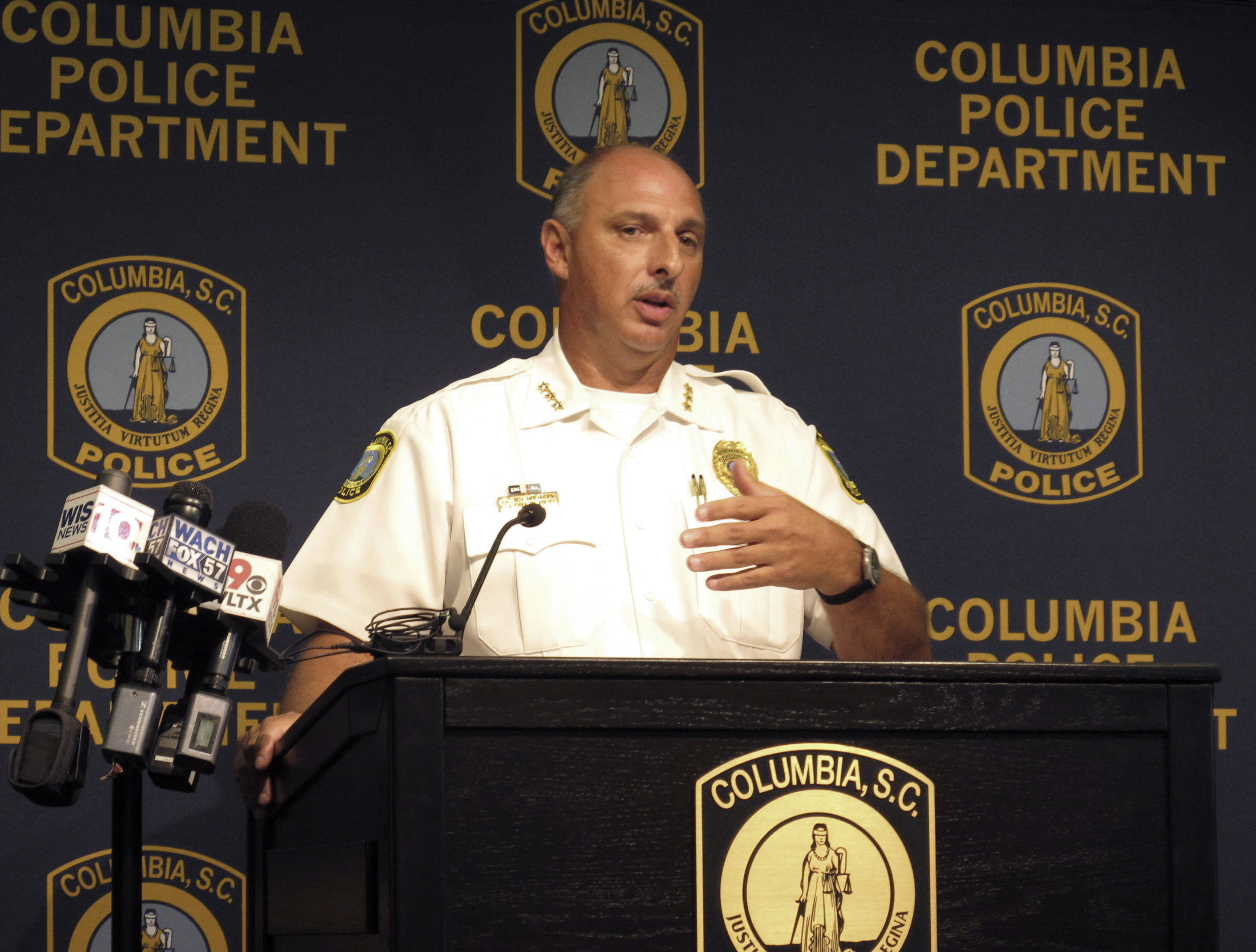 """Columbia Police Chief Skip Holbrook talks Thursday, Aug. 23, 2018, in Columbia, S.C., about an investigation into the heat-related death of police dog """"Turbo"""" in July. Holbrook said the handler, Master Police Officer David Hurt, violated police policy by leaving the dog alone for six hours and has been suspended without pay for five days. (AP Photo/Jeffrey Collins)"""