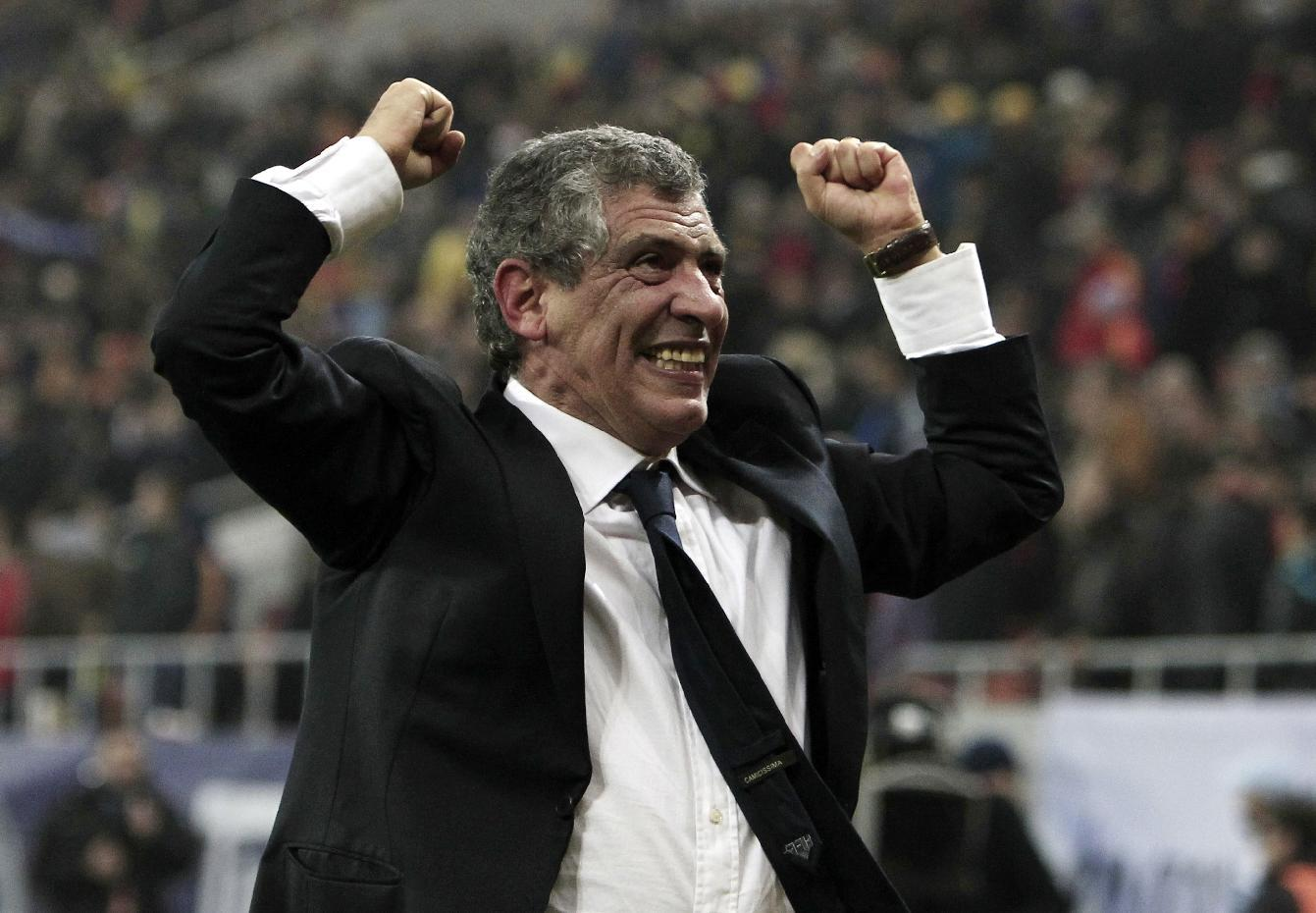 FILE - In this Tuesday, Nov. 19, 2013 file photo, Fernando Santos, the coach of Greece, celebrates after defeating Romania in their World Cup qualifying playoff second leg match at the National Arena in Bucharest. Greece's Football Association said Thursday Feb. 27, 2014, that national coach Fernando Santos will step down following the World Cup in Brazil, after a successful four-year term on the job that saw the country rise to 12th place in the the FIFA world rankings. (AP Photo/Thanassis Stavrakis, File)