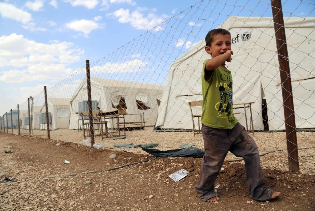 A Yazidi boy from Iraq, seen at a refugee camp in the Kurdish town of Derik (aka al-Malikiyah in Arabic) on the Turkey-Iraq border, in September 2015 (AFP Photo/Delil Souleiman)