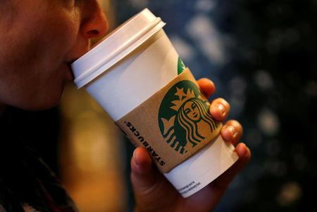FILE PHOTO: A customer sips her coffee in Starbucks' Mayfair Vigo Street branch in central London, Britain, September 12, 2012. REUTERS/Andrew Winning/File Photo