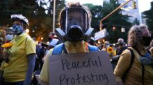 Thousands gather outside central police precinct as Portland protests continue