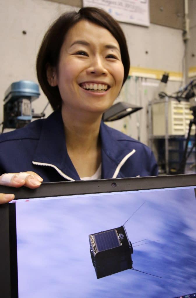 Lena Okajima, CEO of a space technology venture ALE, speaks about her latest project, in Tokyo (AFP Photo/Yoshikazu Tsuno)
