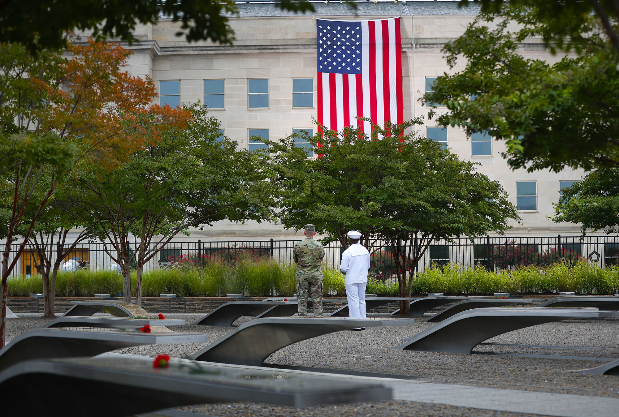 <p>Members of the military are seen on the grounds of the National 9/11 Pentagon Memorial before the start of the September 11th Pentagon Memorial Observance at the Pentagon on the 17th anniversary of the September 11th attacks, Tuesday, Sept. 11, 2018. (AP Photo/Pablo Martinez Monsivais) </p>