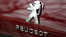 PSA picks Peugeot for U.S. return as rides record profit