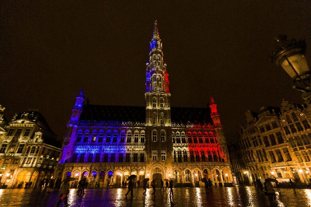 The town hall of Brussels is illuminated with the colours of the French national flag, at the Brussels Grand Place, on November 14, 2015, a day after deadly attacks in Paris (AFP Photo/James Arthur Gekiere)