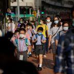 Coronavirus world round-up: Hong Kong closes schools amid rising cases