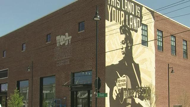 Local Tulsa artist paints mural of Woody Guthrie in Brady Art District