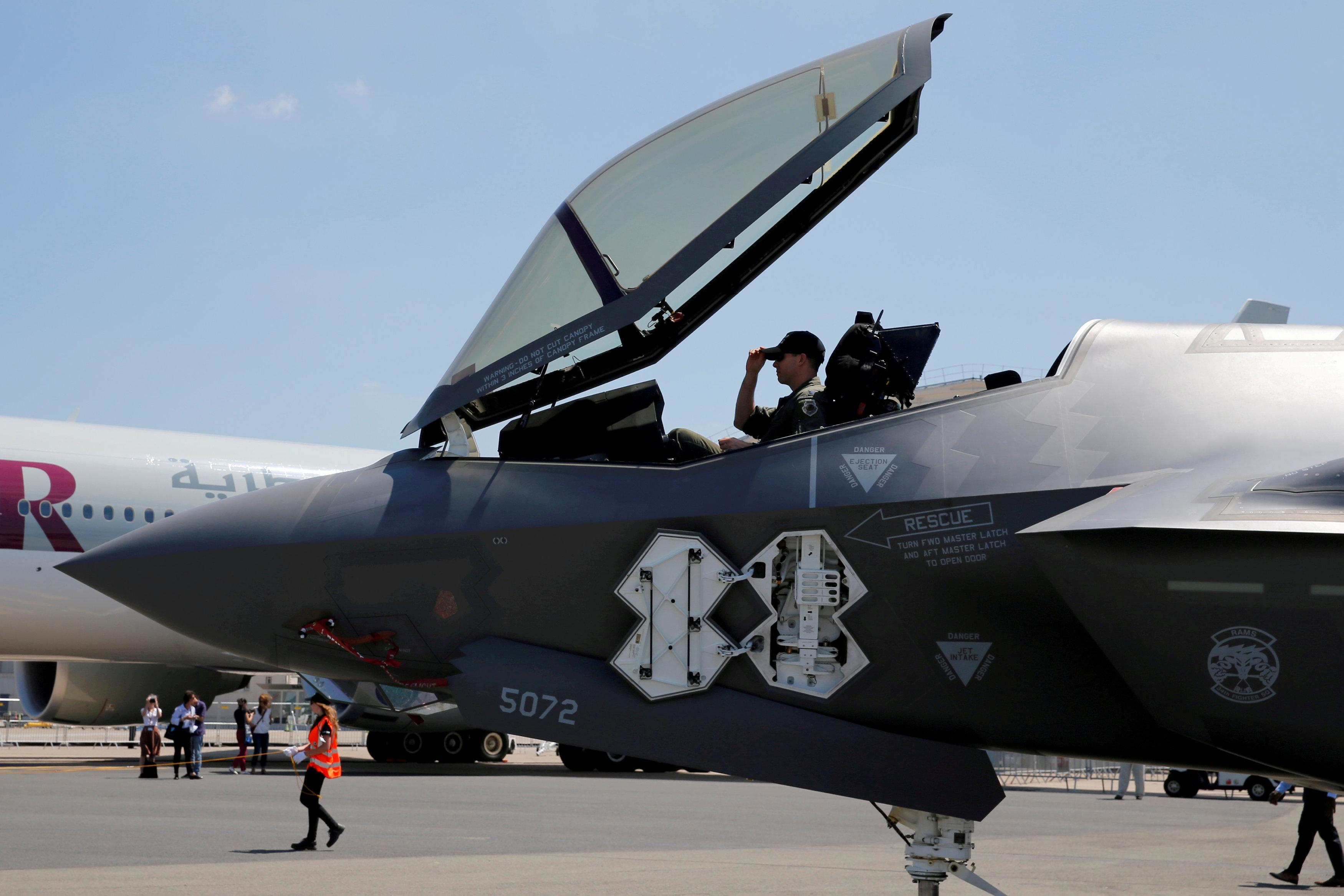 FILE PHOTO: A U.S. soldier adjusts his cap in the cockpit as a Lockheed Martin F-35 Lightning II aircraft is moved on the eve of the 52nd Paris Air Show at Le Bourget Airport near Paris, France, June 18, 2017. REUTERS/Pascal Rossignol/File Photo