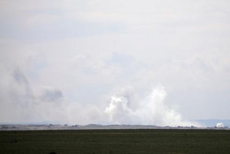 Plumes of smoke rise near Baghouz, Deir Al Zor province, Syria February 11, 2019. REUTERS/Rodi Said