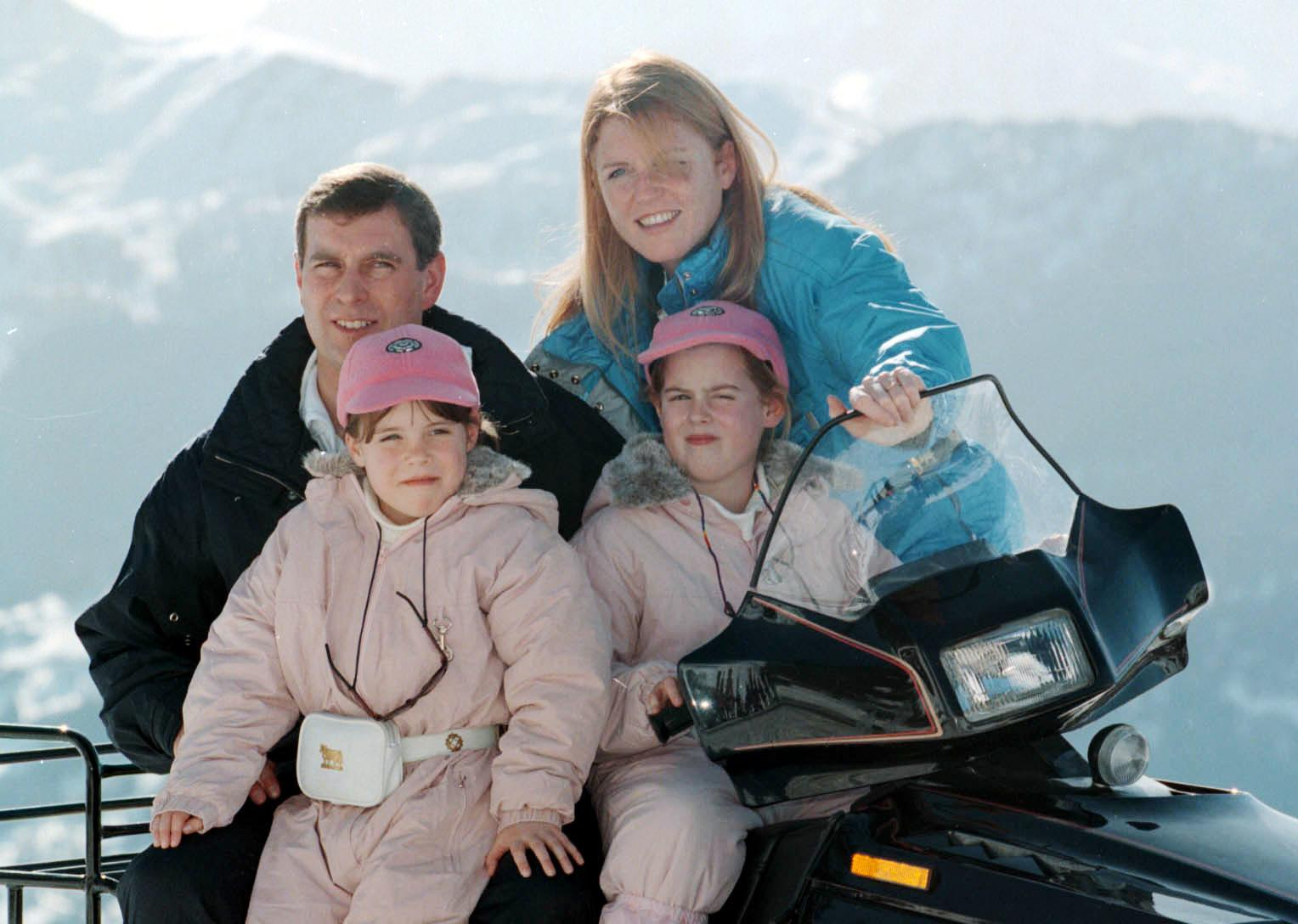 The Duchess of York with former husband the Duke of York,   during a photocall with their daughters Princesses Beatrice (right), nine, and seven-year-old Eugenie in Verbier, Switzerland today (Thursday).  PA PIC NEIL MUNNS.  See PA Story ROYAL Duchess.  07/03/98: The Princesses could be stripped of their HRH titles in a round of reforms to further modernise the monarchy, announced today (Saturday).  The proposals include restricting the style His or Her Royal Highness to senior royals; confirming that bowing and curtseying to royals is not compulsory; and finally closing the door on palace grace-and-favour accommodation. See PA Story ROYAL Reform.