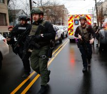 1 Officer and 3 Civilians Killed, 2 Suspects Dead in 4-Hour Jersey City Standoff