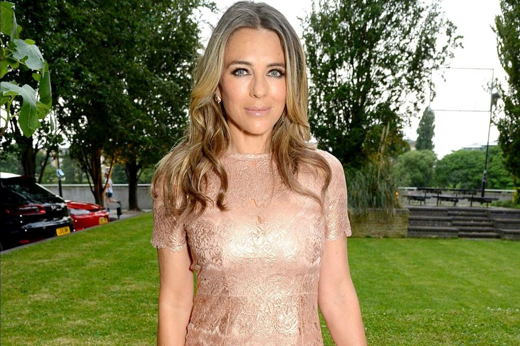 Elizabeth Hurley Turns Heads in Skintight Rose Gold Dress and Matching Sandals With a Pedi That Pops