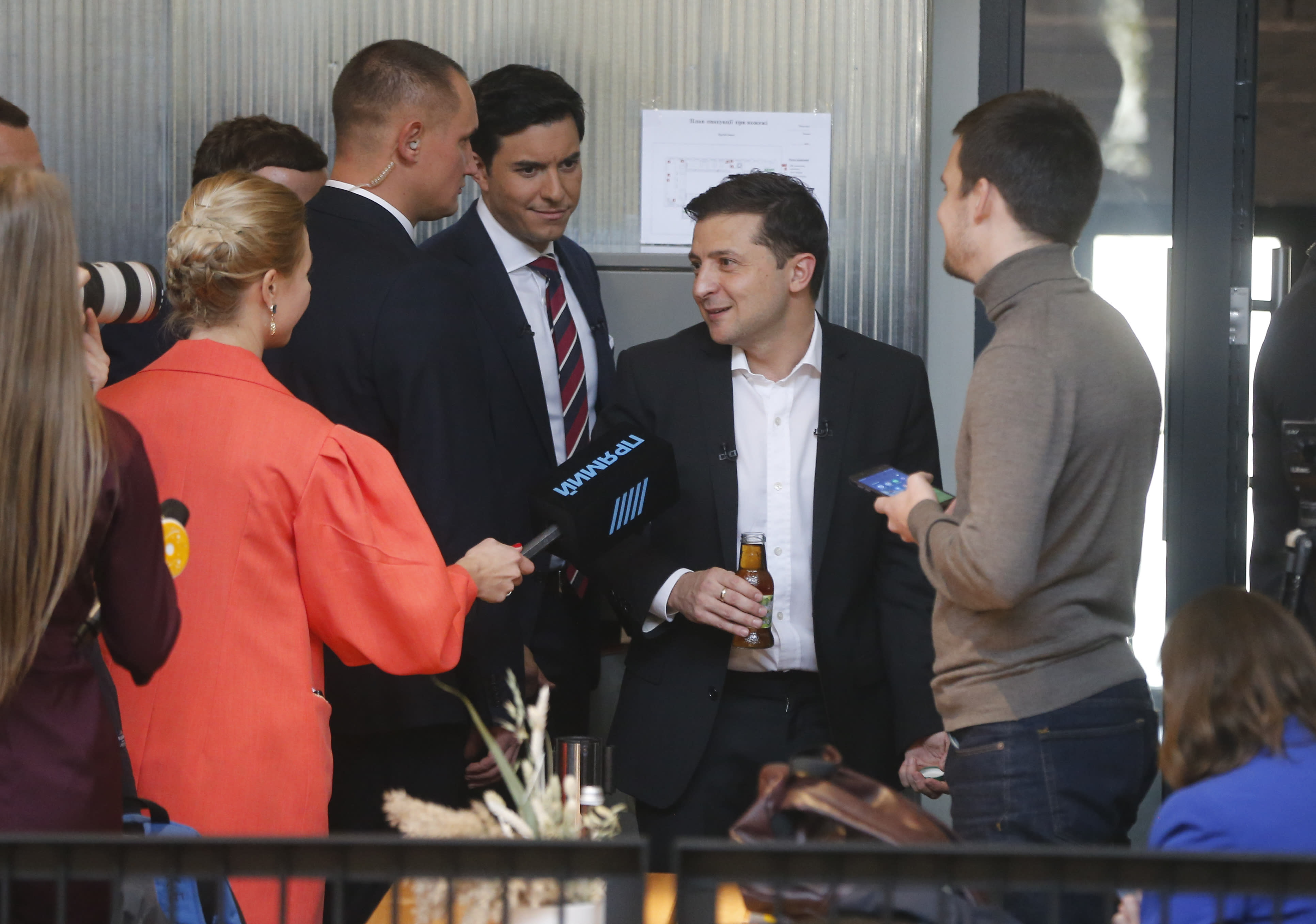"""Ukrainian President Volodymyr Zelenskiy speaks with journalists during in an all-day """"media marathon"""" held in a food court in Kyiv, Ukraine, Thursday, Oct. 10, 2019. Ukrainian President is holding an all-day """"media marathon"""" in a Kyiv food court amid growing questions about his actions as president. (AP Photo/Efrem Lukatsky)"""