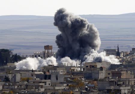 An explosion following an air strike is seen in western Kobani neighbourhood