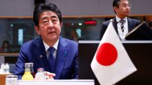 Japan PM Abe 'relieved' at hostage's release but wants to confirm identity