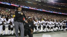 Raiders sit for national anthem, Dan Snyder links arms with Redskins