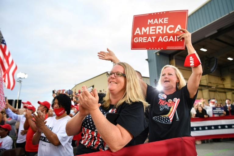 Donald Trump supporters applaud during his rally at the Pennyslvania airport Latrobe on September 3, 2020