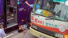 Tourist bus driver beaten unconscious with metal water bottle in Hong Kong road rage attack