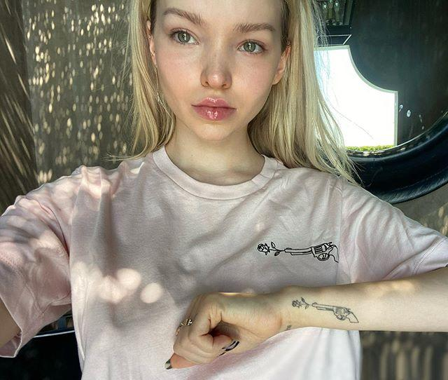 """<p>The actress inked a beautiful tribute to her late friend and costar Cameron Boyce, who died suddenly in July 2019 after suffering a seizure in his sleep due to epilepsy.</p> <p>The tattoo, which looks like a gun shooting a rose, symbolizes Boyce's anti-gun-violence initiative, Wielding Peace. Cameron also teamed up with the campaign, which is selling merchandise with the same design to help """"end gun violence and cure epilepsy.""""</p> <p>""""Cameron was the most beautiful soul most of us will ever know,"""" the actress wrote on Instagram.</p>"""