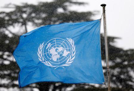 A United Nations flag flies outside the the European headquarters of the United Nations in Geneva