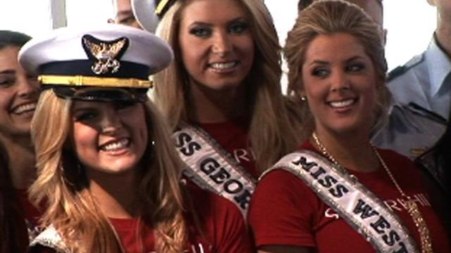 Miss USA contestants salute the armed forces