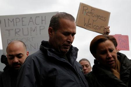 Iraqi immigrant Hameed Darwish stands with Congresswoman Nydia Velazquez (R) after being released at John F. Kennedy International Airport in Queens, New York. REUTERS/Andrew Kelly