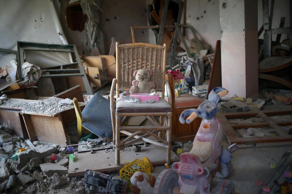 Toys are seen in a room where an NGO used to work with disabled children before the building was damaged during the 50-day war between Israel and Hamas militants in the summer of 2014, in Gaza City's eastern suburb of al-Shejaiya on August 25, 2015 (AFP Photo/Mohammed Abed)